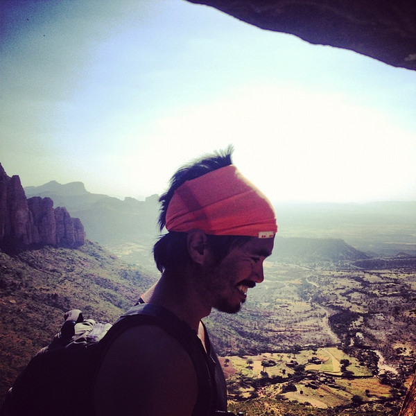 The tangerine enso Men's headband and explorer high in the hills of ethiopia