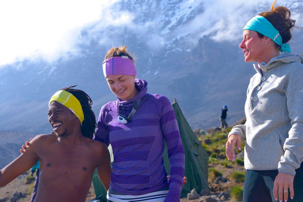 KOOSHOO headbands bringing color to the slopes of Mt. Kilimanjaro in Africa, thanks to Melanie Trepanier (center)