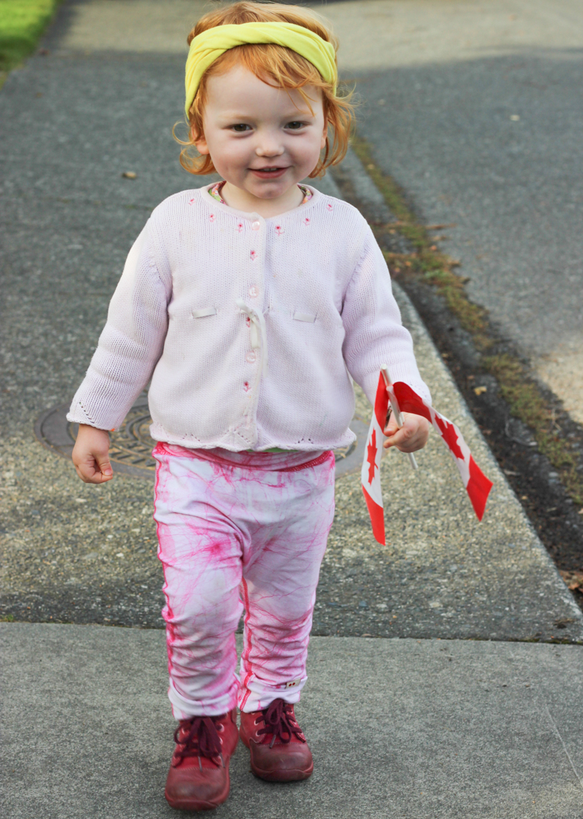 Proudly  waling home in her magenta pink kids pants after mailing our KOOSHOO package to the royal family.