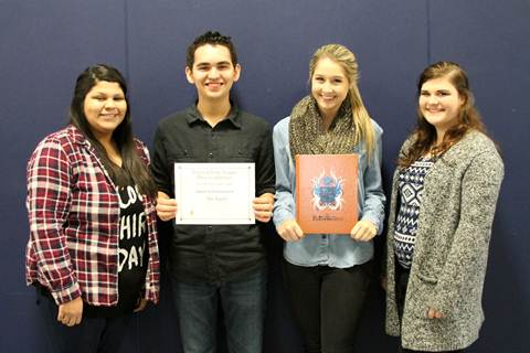 North Lamar High School 2014 yearbook editors Lydia Jimenez, Ryan Reily, Gabby Keys, and Raven Worthy proudly hold the awards they received from the Interscholastic League Press Conference.