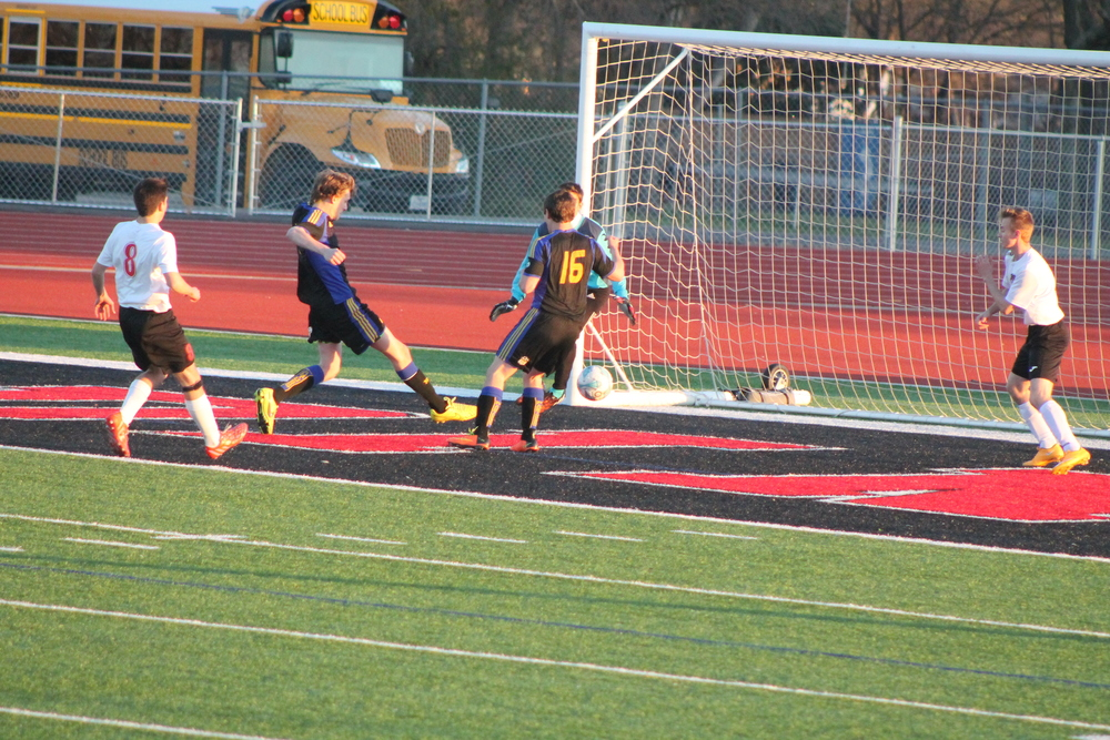 (Photo by Jared Routon) Hunter Love scores a goal against Melissa.
