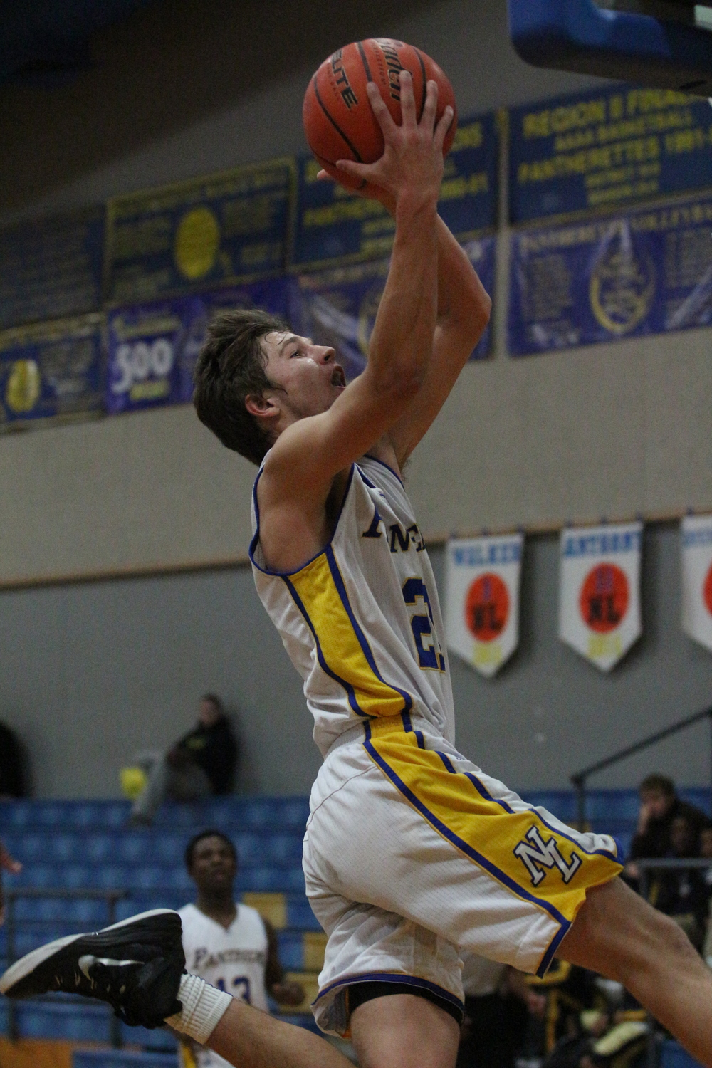 (Photo by Bill Higgins) Tyler Anthony going in for a layup on Senior Night against Pittsburg.