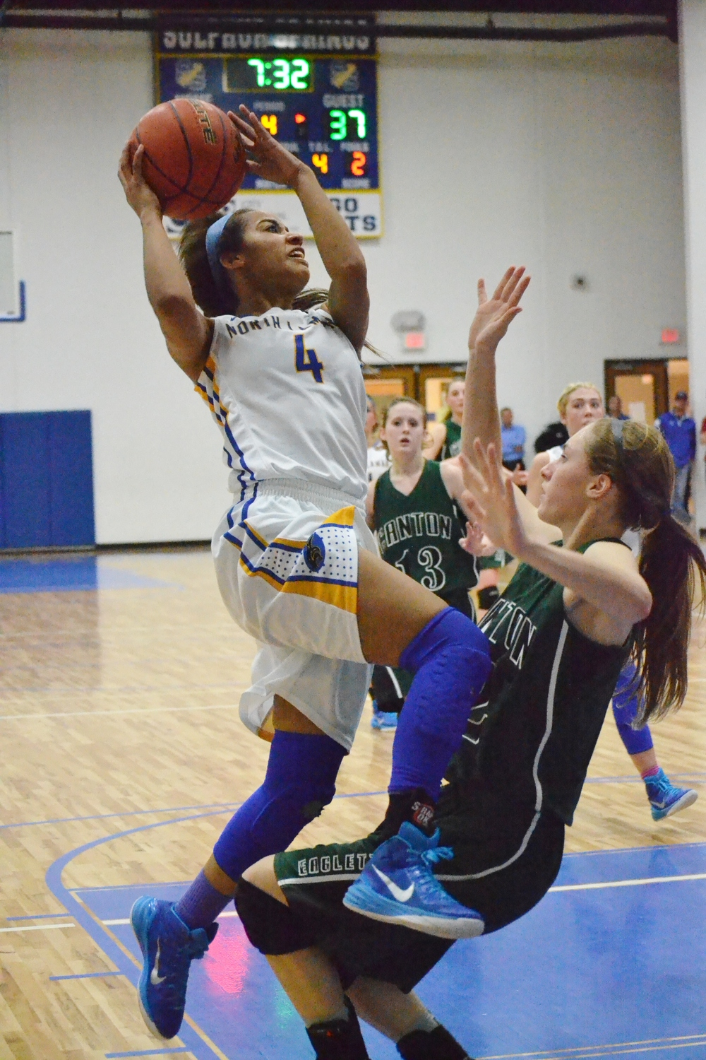 (Photo by Bev White) Aaryn Honeywood driving for a layup against Canton.