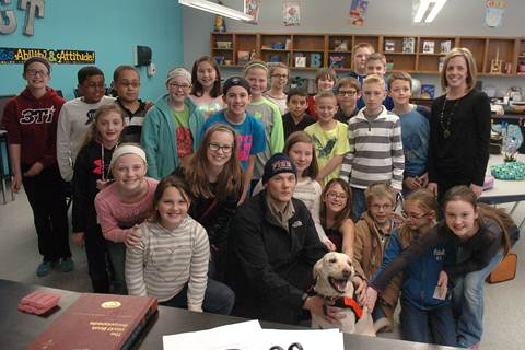 Paris Firefighter Matthew Jones and K-9 Sadie quickly made friends with Shelly Biven's 5th grade GT students at Bailey Intermediate School.