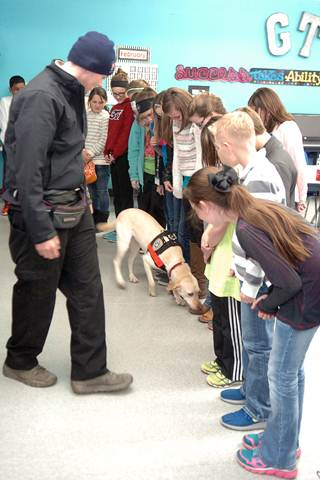 To demonstrate the keen sense of smell of an arson dog, Bailey 5th grade GT students lined up to see if Sadie could detect the shoe that had an accelerant on them.
