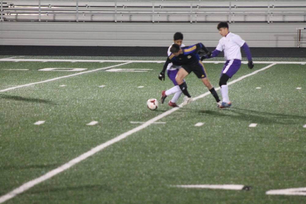 (Photo by Adam Routon) Korbin Peralta fighting to maintain possession of the ball.