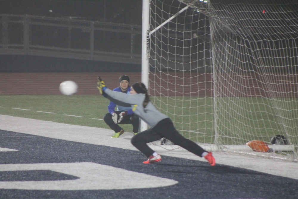 (Photo by Adam Routon) North Lamar goalie Shaina Brown making the game-winning save against Paris High.