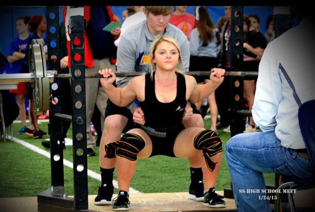 Kayedon Oliver Squatting  at a meet in Sulphur Springs