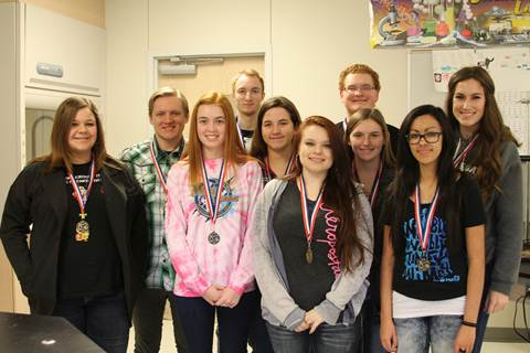 Finalists from North Lamar High School's Pre-AP Biology semester research projects went on to compete at the East Texas Regional Science Fair.  Shown with medals they earned on their North Lamar projects beginning first row left are Cierra Williams and Megan Grogan; middle row, Chloe Whisenhunt, Bailey Fowler - 3rd place tie 'Eradicating Algae', Heather Armstrong - 2nd place 'Lactose Intolerance', Gracie Blake and Summer Andrews; and back row, Seth Gurley - 1st place 'TB Vaccinations', Dillon Barnett - 3rd place tie 'Water in Paris', and Jared Chenevey.