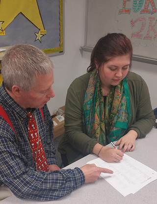 North Lamar High School UIL Social Studies Coach Dennis Hodgkiss works on contest materials during an afternoon practice with Social Studies team member Sophomore Kay Edwards.