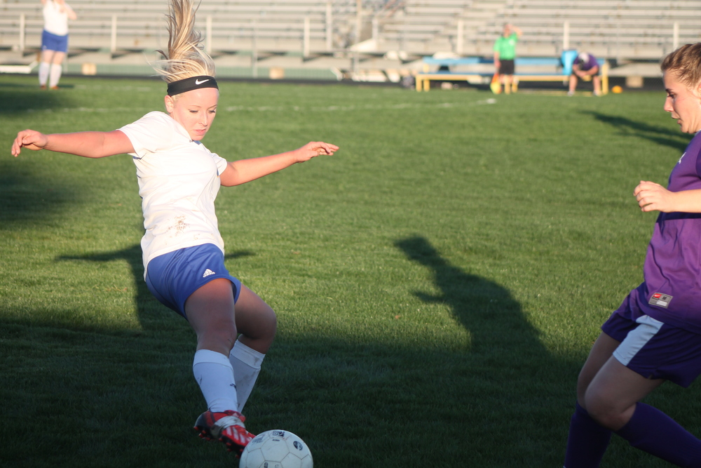 (Photo by Maddie Routon) Natalie Allen stretches for the ball against Bonham.