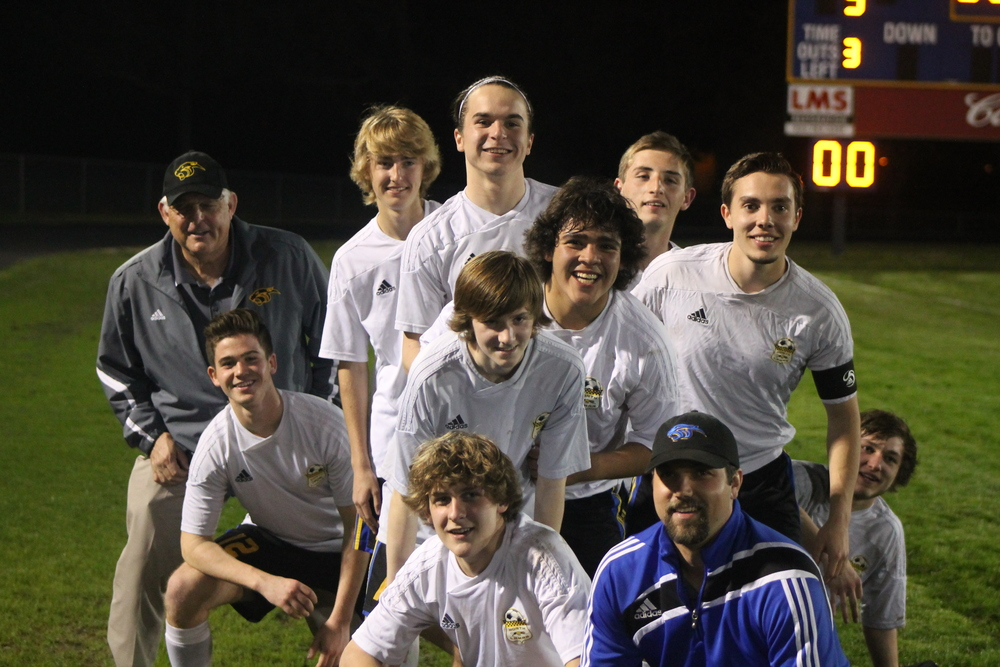 (Photo by Jared Routon) North Lamar Seniors celebrate their win over Bonham.