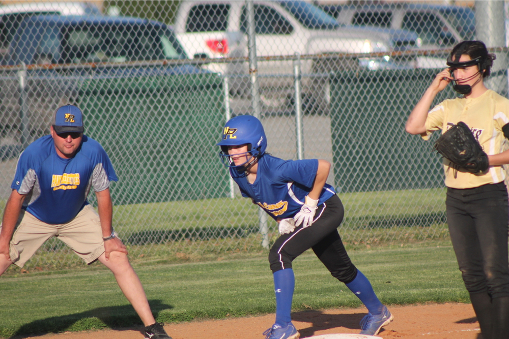 Reagan Richardson on third base before scoring the first run of the game for North Lamar.