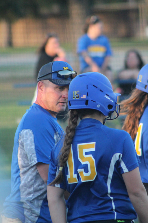 Coach Fendley discussing strategy with North Lamar senior Tanna Huie before she goes to bat Wednesday night.