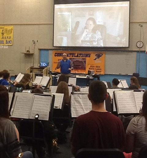 Band director Jason R. Smith directs the North Lamar band as they skype with the composer of the piece they are working on for contest.