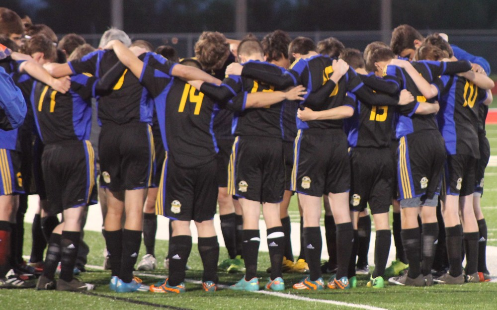 (Photo by Jared Routon) North Lamar team huddled together Friday night.