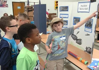 Rhett Bestul comfortably talked about what he had learned about The Great Barrier Reef in Australia to Caleb Echols (left) and J. T. Franklin (center).