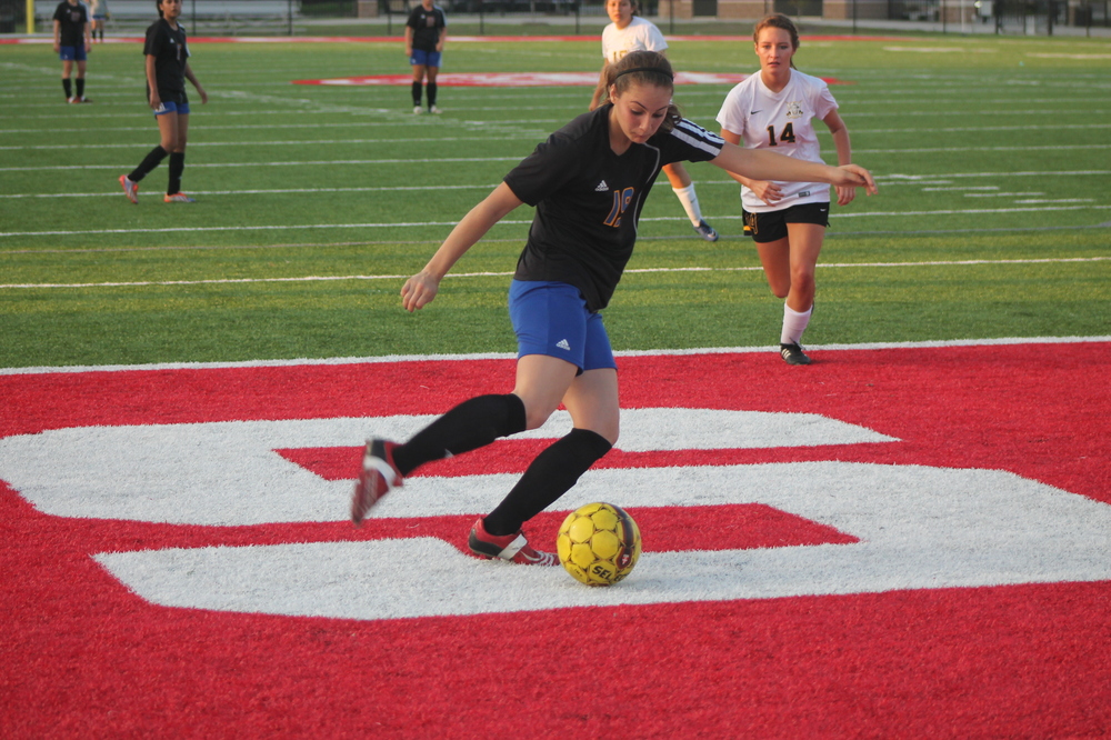 (Photo by Jared Routon) Madison  Morrison prepares to take a kick against Crandall Tuesday night.