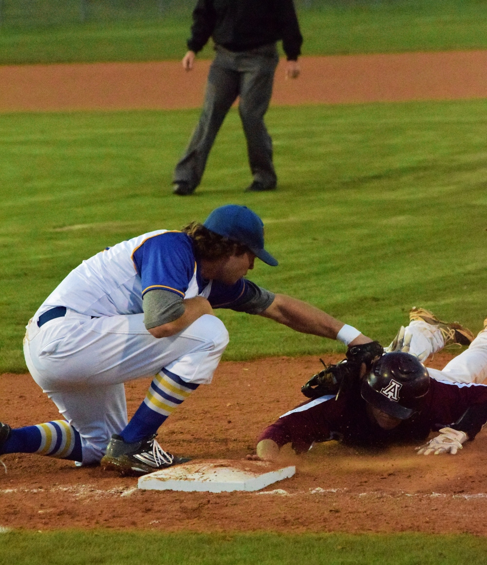 (Photo by Beverly White) Evan Nibblet applying a tag in a game earlier this season.