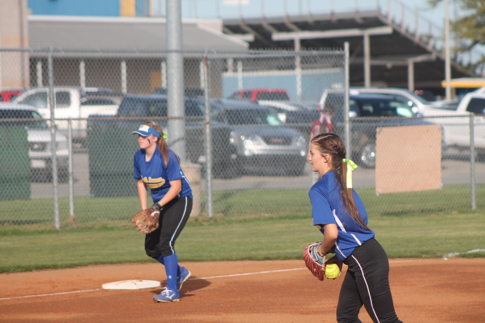 Reagan Richardson getting set to pitch as Erin Scholl watches earlier in the year.