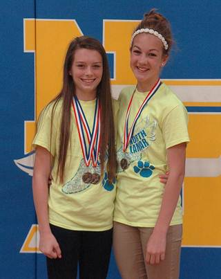 Left, Stone Middle School 8 th grader  Keegan Fendley  was named District Champion in the 2400m run and the 1600m run while 7 th grader  Reyna Hildreth  earned District Champion in pole vault.