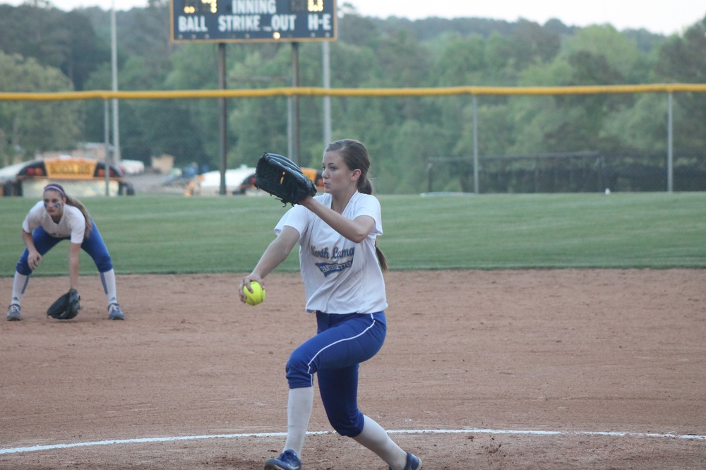 Reagan Richardson delivering a pitch against Tyler-Chapel Hill Thursday night as Madison Morrison watches from short.