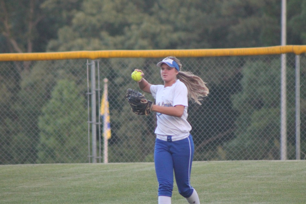 Kayla Igleheart throwing the ball back in from center field after getting an out against Tyler-Chapel Hill.