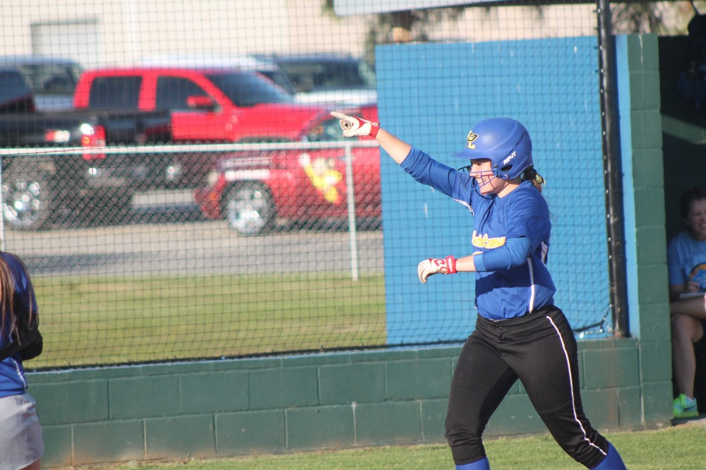 Bailee Nickerson pointing to a spectator as she rounds third base after hitting a two-run home Friday night.