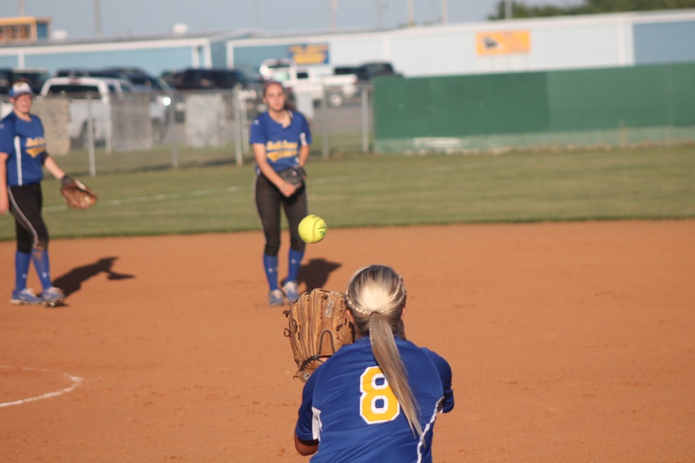 Jordan Jones (8) stretching out to catch a throw from Madison Morrison (SS) Friday night.