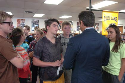 Congressman Ratcliffe mingled with history students at Stone Middle School after addressing the history class as a whole.  Listening intently to what the Congressman had to say, from left, are Hunter Jones, Layne Lankford, Hunter Moore, and Olivia Manuel.