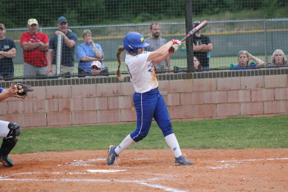 Bailee Nickerson with one of her two hits in Game 1 against Brownsboro.