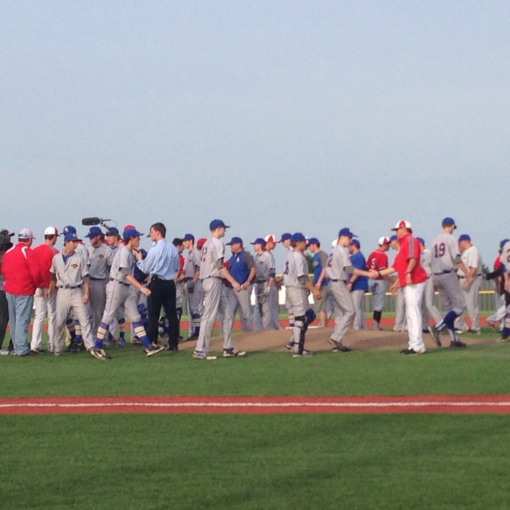 North Lamar and Van shaking hands before Game One. North Lamar presented Van with two checks to show their support.