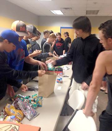 North Lamar Panthers putting together care packages for Van players and coaches.