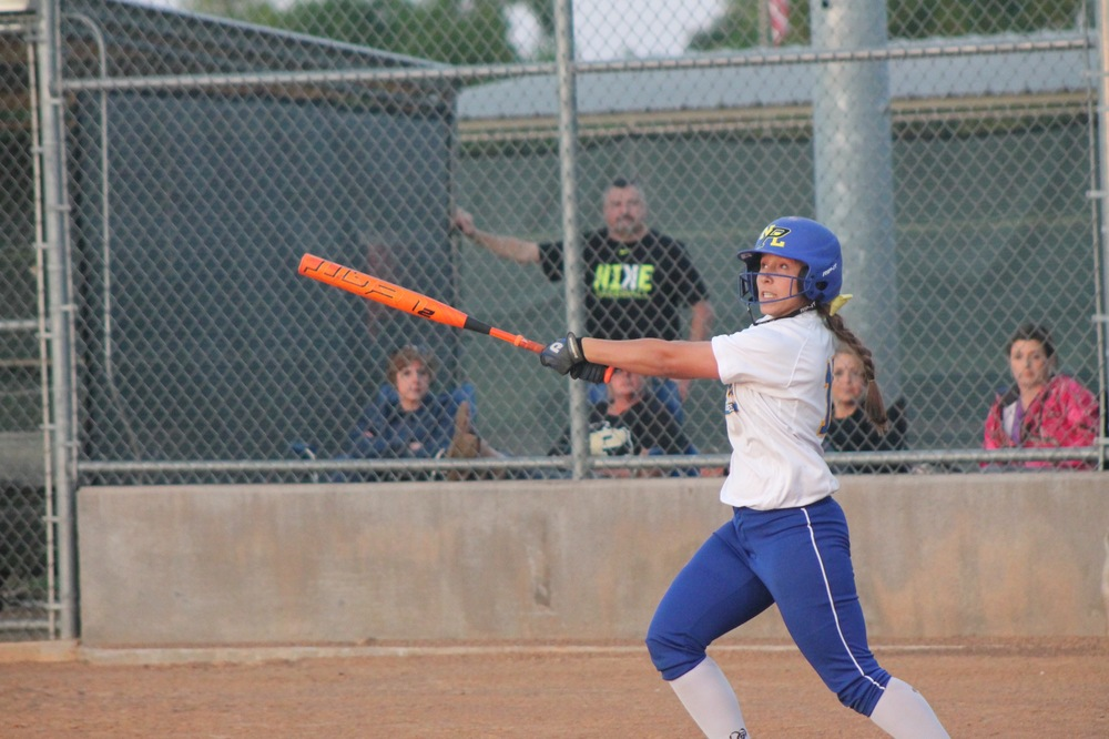 Senior Tanna Huie with a hit earlier in the year.