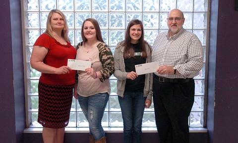 Presenting scholarships to Cheyenne Whitney, middle left, and Riley Preston, middle right, on behalf of the North Lamar Association of Texas Professional Educators (ATPE)   are   Vice President Annette Lewis, and President Jerry Jarrell.