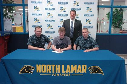 Chase Allen, center, with Petty Officer Sam Money, left, Petty Officer Christopher Gault, right, and NLHS Principal Clint Hildreth, standing.