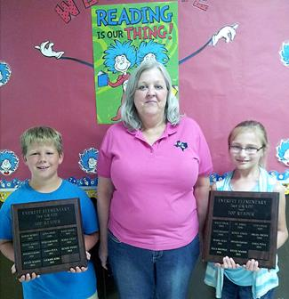 Everett 2014-2015 Top AR Readers   Jackson Kirk, 2nd grade, and Raylee Mahon, 3rd grade, with librarian Lynnette Johnson.