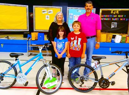 Everett 2nd Grade Bicycle Winners   Kylie Bryant and Mason Kelley   with librarian Lynnette Johnson and   Principal Carey Malone