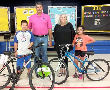 Everett 3rd Grade Bicycle Winners Austin Elrod and Cheyenne Matlock-Johnson   with Principal Carey Malone and   librarian Lynnette Johnson