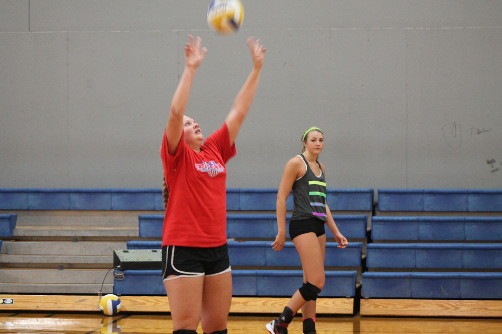 Bill Jones sets the ball as Bailey Foy watches during a practice at North Lamar gym.