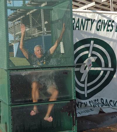 North Lamar Athletic Director Tim Billings takes a plunge in the dunking booth at the 2014 Fall Sports Kickoff Party.