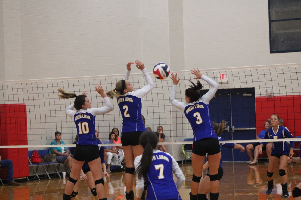 Mara Mabry (10), Jaycie McFatridge (2) and Katee Garrett going for up a block as Mary Gilbert (7) watches.