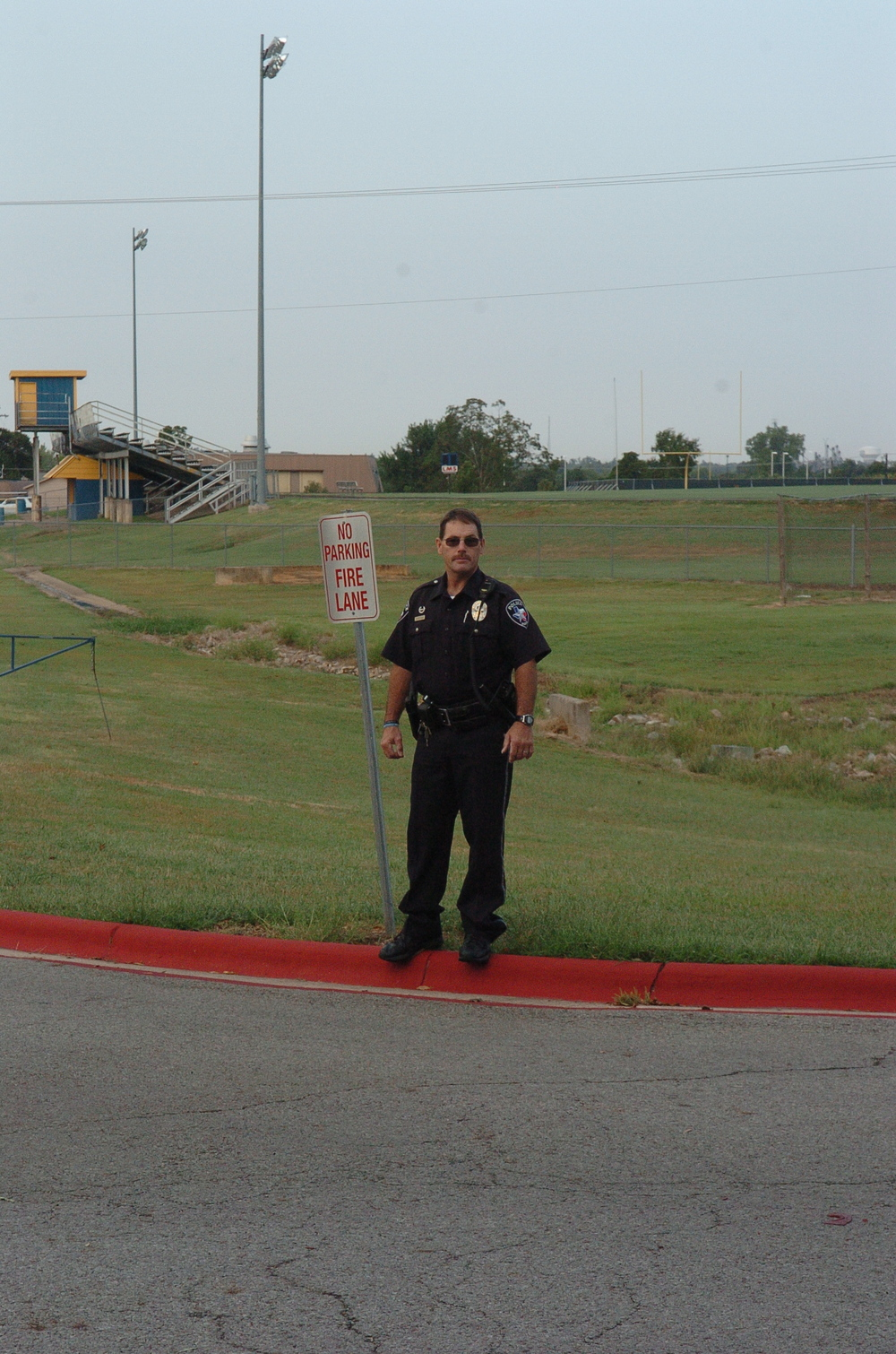 Officer Whitaker helps direct traffic at North Lamar as  parents take their children to school   on Monday   morning.