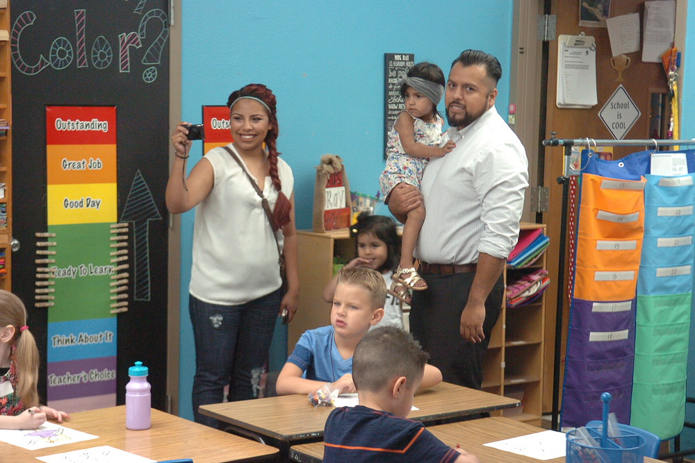 Capturing their daughter's first day of kindergarten at Higgins Elementary are Yolanda and Carlos Hernandez.