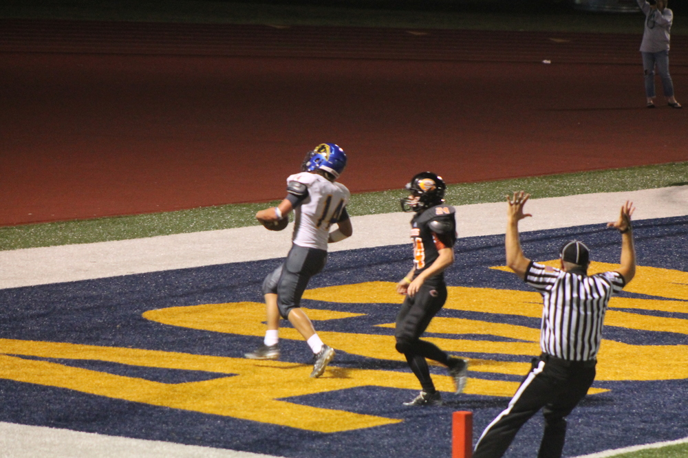 (Photo by Maddy Routon) Ty Waggoner scoring a touchdown in the 3rd quarter for North Lamar.