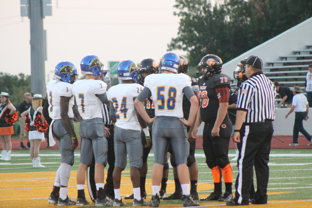 (Photo by Maddy Routon) Trey Scudder (7) before the game with the other captains on the team.
