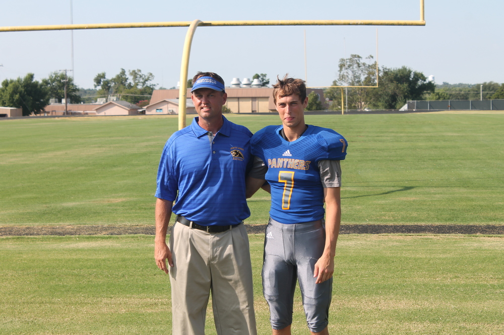 Trey standing with his dad, Scott, on Media Day.