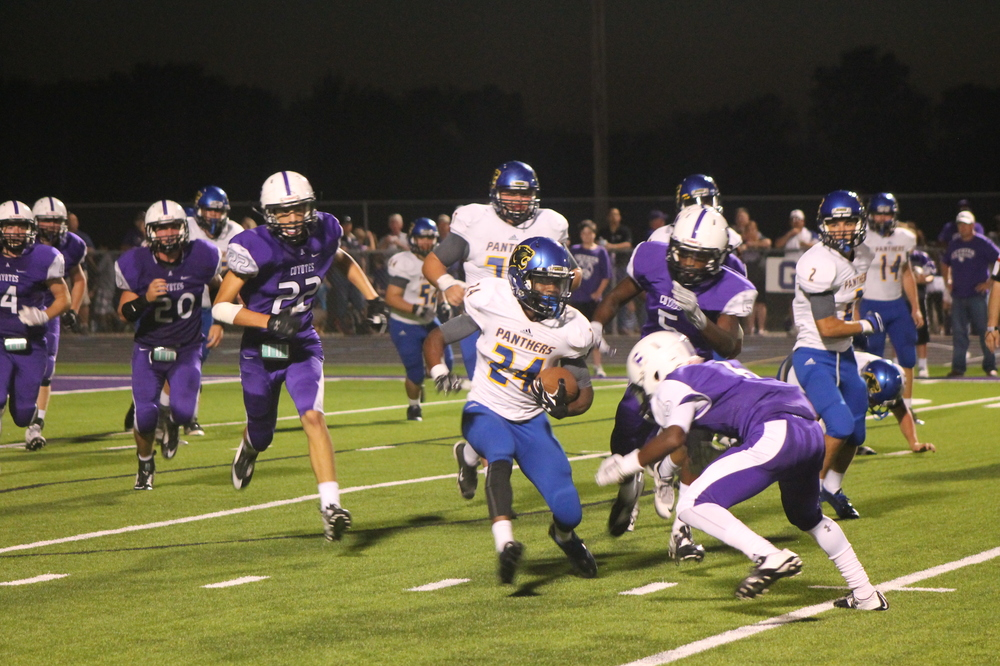 (Photo by Maddy Routon) Javon Franklin avoiding a defender Friday night in Anna
