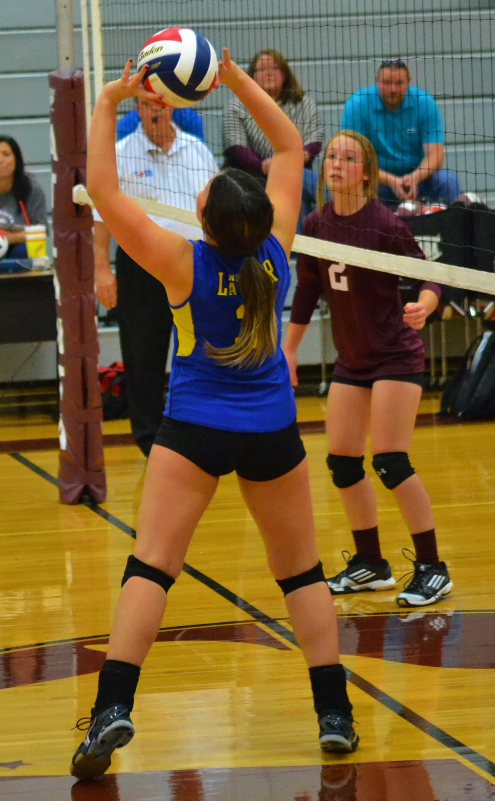 (Photo by Beverly White) Freshman Kimber Scott setting the ball against Atlanta