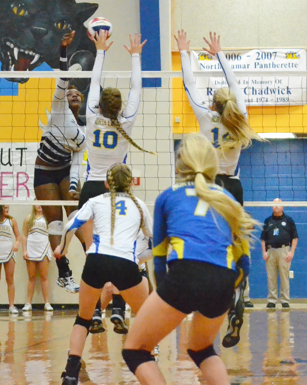 (Photo by Beverly White) Bailee Nickerson (10) and Bailey Foy (14) going for up a block for the Pantherettes against Paris High.